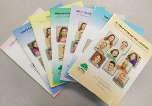Image of fanned out stack of 7 workbooks, colorful covers visible